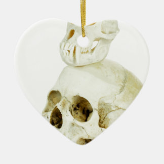 Skulls of human and ape on top ceramic heart ornament