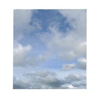 sky. Blue cloudy sky Notepad