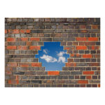Sky through a hole in a brick wall poster