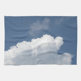 Sky with giants clouds and sun rays through towel