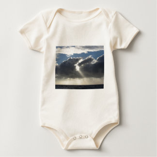 Sky with giants cumulonimbus clouds and sun rays baby bodysuit