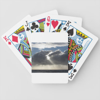 Sky with giants cumulonimbus clouds and sun rays bicycle playing cards