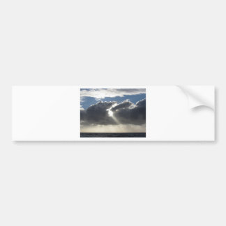 Sky with giants cumulonimbus clouds and sun rays bumper sticker