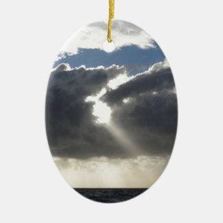 Sky with giants cumulonimbus clouds and sun rays ceramic ornament