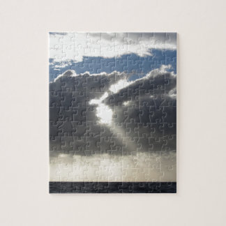 Sky with giants cumulonimbus clouds and sun rays jigsaw puzzle
