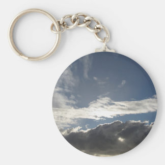 Sky with giants cumulonimbus clouds and sun rays keychain