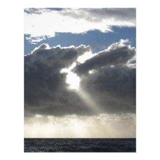 Sky with giants cumulonimbus clouds and sun rays letterhead