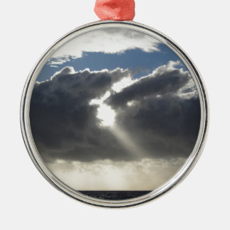 Sky with giants cumulonimbus clouds and sun rays metal ornament