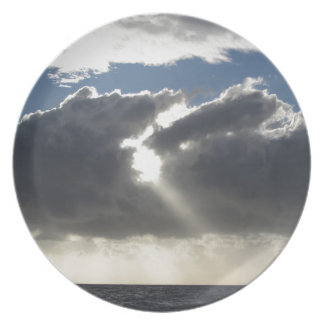 Sky with giants cumulonimbus clouds and sun rays plate