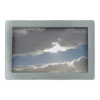 Sky with giants cumulonimbus clouds and sun rays rectangular belt buckle