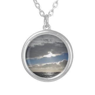 Sky with giants cumulonimbus clouds and sun rays silver plated necklace