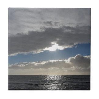 Sky with giants cumulonimbus clouds and sun rays tile