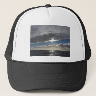 Sky with giants cumulonimbus clouds and sun rays trucker hat