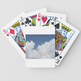 Sky with giants cumulonimbus clouds bicycle playing cards