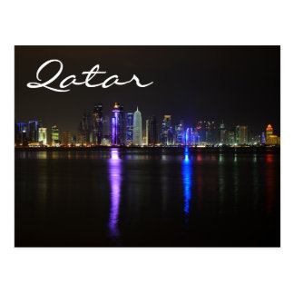 Skyline of Doha, Qatar at night text postcard