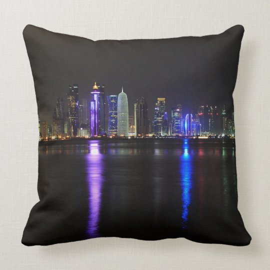 Skyline of Doha, Qatar at night throw pillow