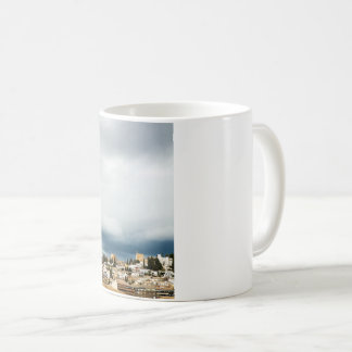 Skyline of the historic part of a city on a storm coffee mug