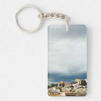 Skyline of the historic part of a city on a storm keychain