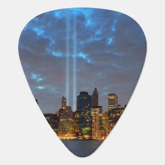 Skyline view of city in night. guitar pick
