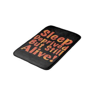 Sleep Deprived But Still Alive in Fire Tones Bathroom Mat