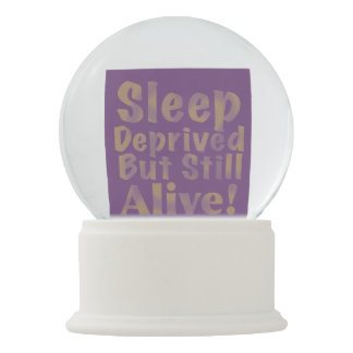Sleep Deprived But Still Alive in Yellow Snow Globe