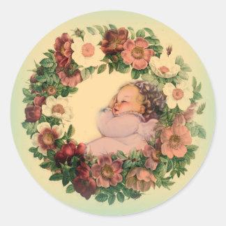 Sleeping Baby in Floral Wreath Classic Round Sticker