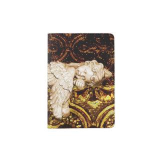 Sleeping cherub on dark golden glass passport holder