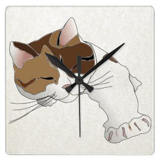 sleepy calico cat wallclocks