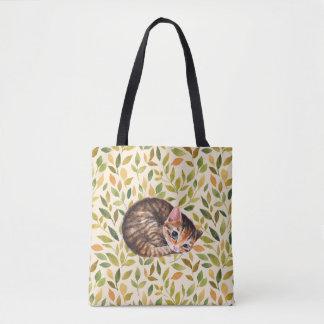 Sleepy cat, floral background tote bag