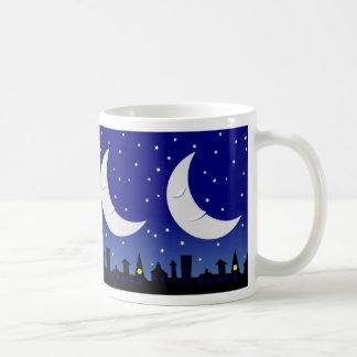 Sleepy moon over town mug