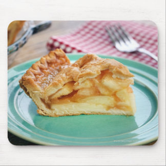 Slice of fresh baked apple pie on plate mouse pad