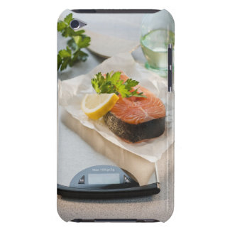 Slice of salmon on weight scale iPod Case-Mate cases
