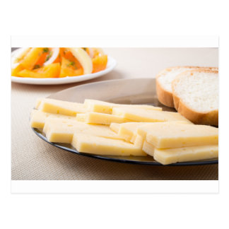 Slices of cheese and bread on a plate closeup postcard