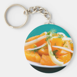 Slices of orange tomato on a plate with onions basic round button keychain