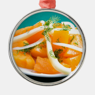 Slices of orange tomato on a plate with onions Silver-Colored round ornament