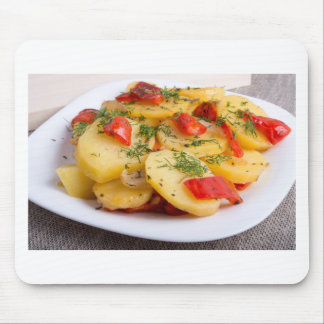 Slices of stewed potatoes and peppers on sackcloth mouse pad