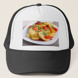 Slices of stewed potatoes and peppers on sackcloth trucker hat