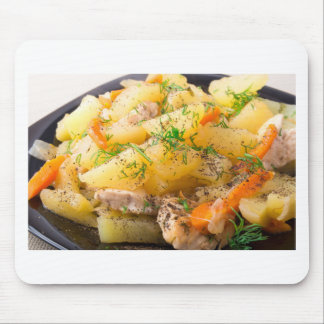 Slices of stewed potatoes, chicken, carrot mouse pad