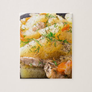 Slices of stewed potatoes, chicken, carrot puzzle