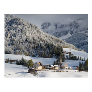 Small alpine village in the snow postcard