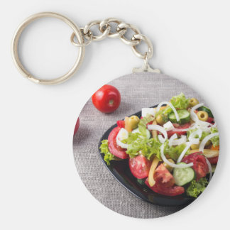 Small bowl of salad made from natural vegetables basic round button keychain