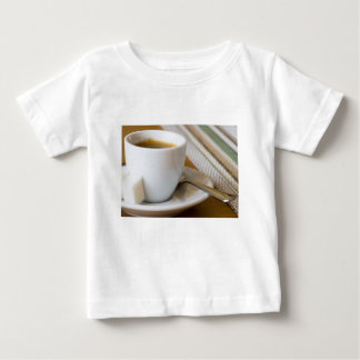Small cup of espresso on a saucer with sugar baby T-Shirt