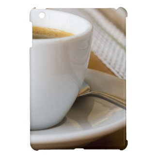 Small cup of espresso on a saucer with sugar cover for the iPad mini