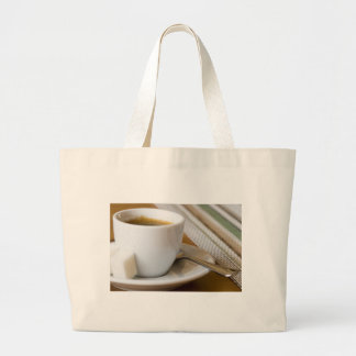 Small cup of espresso on a saucer with sugar large tote bag