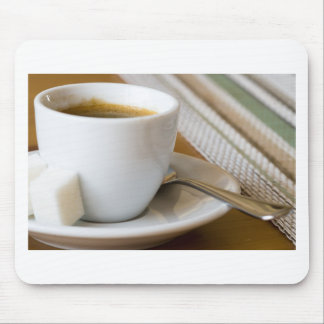 Small cup of espresso on a saucer with sugar mouse pad