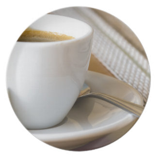 Small cup of espresso on a saucer with sugar plate