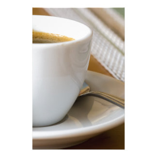 Small cup of espresso on a saucer with sugar stationery