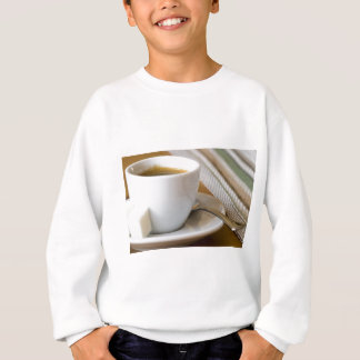 Small cup of espresso on a saucer with sugar sweatshirt
