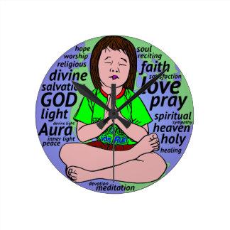Small girl praying and meditating,sitting on earth clock