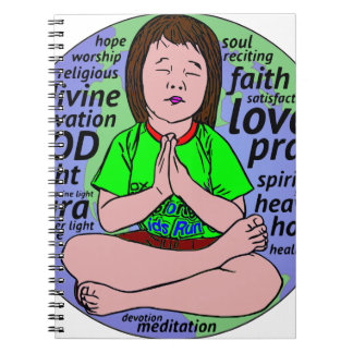 Small girl praying and meditating,sitting on earth notebooks
